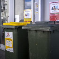 Image of co-mingled recycling bins on a balcony